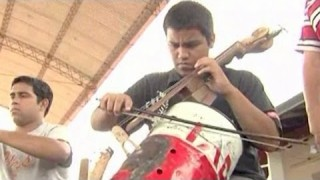 Children's Orchestra Play Instruments Made from Trash