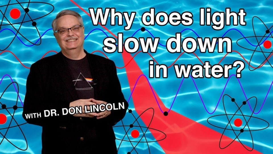 Why does light slow down in water?